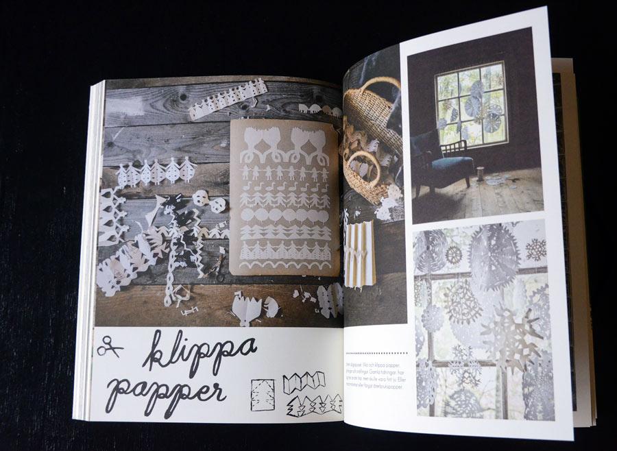 Inspirerande pappersklipp! I boken finns också uppmaningar och beskrivningar att göra själv, bland annat att klippa till med saxen. (Foto uppslag Kurbits)